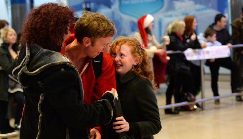 PJ O' Meara back from Australia, is welcomed by his mother Addy and sister Leah from Kilkenny. Photograph: Dara Mac Donaill / The Irish Times