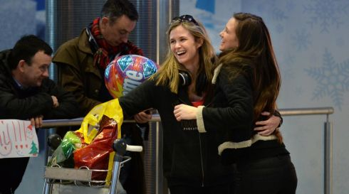23/12/2013.   WEB... NEWS ... Aisling Meyler (right) from Bunclody Co Wexford meets her sister Ciara Meyler, off the plane from Perth, Australia. Photograph: Dara Mac Donaill / The Irish Times