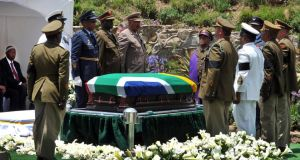 The coffin of former South African President Nelson Mandela is prepared to be buried during his funeral ceremony in Qunu, Eastern Cape. Photograph: South African Government Communication and Information System (GCIS)/Reuters