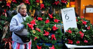 Bernie Darcy  selling Christmas wreaths on Moore Street, Dublin. Photograph: Aidan Crawley