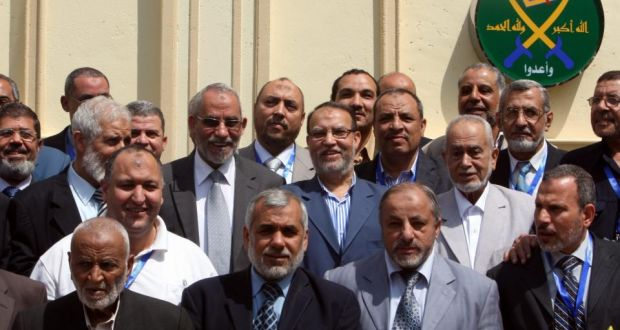 A file photo dated April 2011 shows the then Egypt's Muslim Brotherhood Supreme Guide Mohammed Badie (3rd row, 3-left) standing amongst members of the group's Shura Council as they pose for a group photo after their meeting in Cairo, Egypt. Egyptian state television reported today that the Egyptian government has labeled the Muslim Brotherhood a terrorist group. The government on has blamed the Muslim Brotherhood for an attack that targeted a regional police headquarters in northern Egypt which killed 15 people and injured more than 130. Photograph: EPA/Khaled Elfiqi