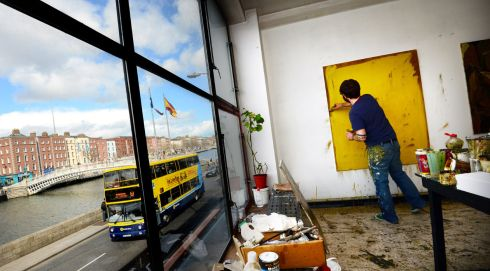 Artist Damien Flood at work on a piece in his studio at Temple Bar Gallery and Studios beside the river Liffey in Dublin. He was one of 250 artists who opened their workspaces to the public over two weekends in May. Photograph: Bryan O'Brien/The Irish Times