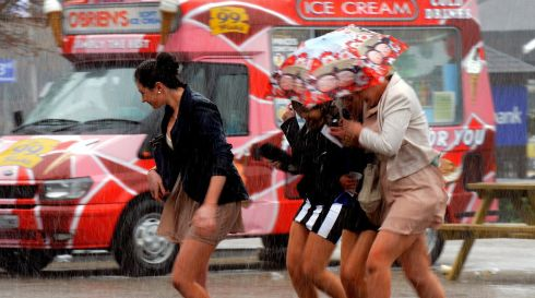 Girls run for cover during a flash of hailstones at Punchestown races in April. Photograph: Cyril Byrne/The Irish Times