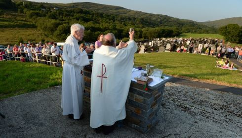 Fr Ted Harrington (left) and Fr Martin Sheehan celebrating the Pattern Mass at St Kilian's cemeterey, Kilmackillogue, Co Kerry, in July.  Photograph: Frank Miller/The Irish Times