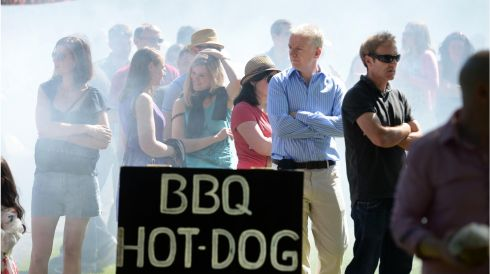 Queueing in the smoke filled BBQ area at the BBQ Family Day in May organised by One Family in the Iveagh Gardens, Dublin. Photograph: Dara Mac Dónaill/The Irish Times