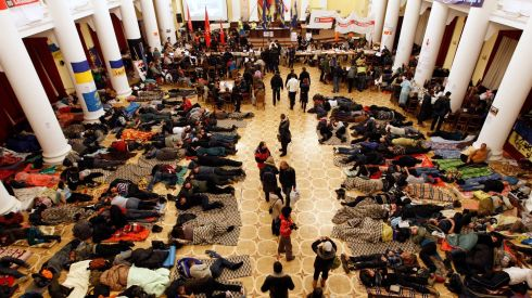 Protesters rest in Kiev's City Hall after it had been turned into an organisational hub for pro-EU protesters who occupied the building in protest against policies of President Victor Yanukovych. Photograph: Vasily Fedosenko/Reuters