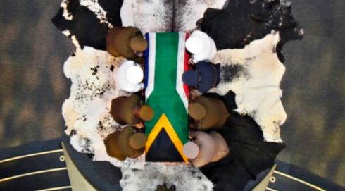 The coffin holding the remains of Nelson Mandela is carried by military personnel at the end of his funeral service in his ancestral village of Qunu, South Africa. Photograph: Reuters
