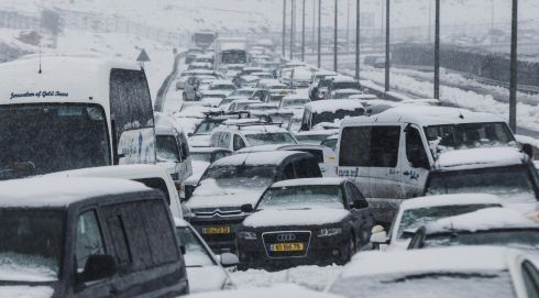Hundreds of cars sit stuck during a snow storm on one of the two main highways to Jerusalem. Photograph: Uriel Sinai/Getty Images