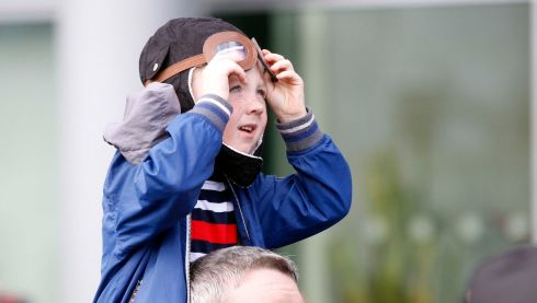 Getting the headgear just right: a boy enjoys the aerial fun at the IAA FlightFest over Dublin. Photograph: Robbie Reynolds