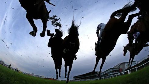 Riders and runners clear a fence during the fifth race on the first day at Leopardstown Christmas Festival 2013. Photograph: Cathal Noonan/Inpho