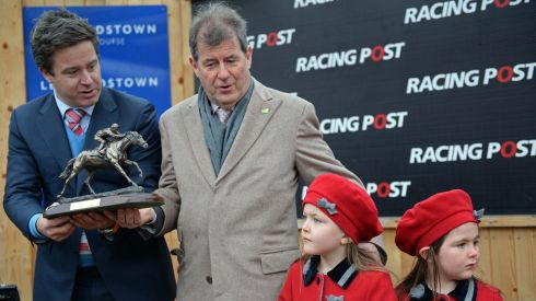 Jonathan Mullins, managing director of Racing Post, with JP McManus with his grandchildren, Katie (6) and Vivienne (5), after his horse Defy Logic won The Racing Post Novice Steeplechase at the Leopardstown Christmas Festival on St Stephen's Day 2013. Photograph:  Eric Luke/The Irish Times