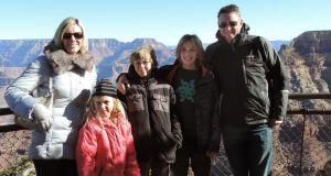 Top of the world at Christmas: Sarah Walsh, Charles Dowd and children William Walsh-Dowd (11), Jonathan Walsh-Dowd (9) and Grace Walsh-Dowd (6) in the United States. Dowd works in the technology industry
