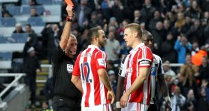 Stoke City's Marc Wilson (left) is sent off against Newcastle at St James' Park. Photograph: Ian Horrocks/Getty Images