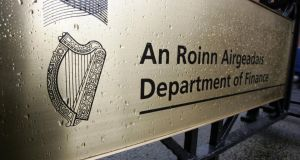 The State harp on a sign outside the department of Finance.