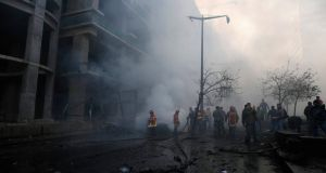 Fire fighting and army personnel inspect the site of an explosion in Beirut's downtown area. Photograph: Steve Crisp/Reuters