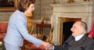 Dr Conn McCluskey meeting former president Mary McAleese: he has died at the age of 98