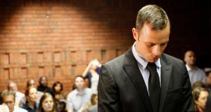 Oscar Pistorius stands in the dock during a break in court proceedings at the Pretoria Magistrates court, February 20, 2013. Photograph: Reuters