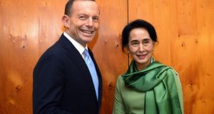 Myanmar's opposition leader Aung San Suu Kyi (R) shakes hands with Australia's Prime Minister Tony Abbott. Photograph:  Reuters/Allan Porrit/Pool