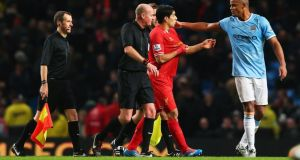 Manchester City captain Vincent Kompany dismisses Luis Suarez's complaint in the St Stephen's Day match at the Etihad Stadium while referee Lee Mason looks on. Photograph: Alex Livesey/Getty Images