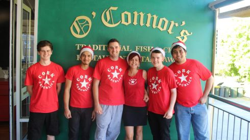 Liz O'Connor and Chris Pender (from Cobh, Co Cork) with their staff at O'Connors Fish & Chips, Brisbane