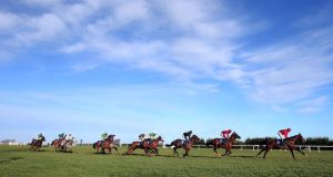 A general view of the runners and riders during the first race of the day. Photograph: Donall Farmer/Inpho