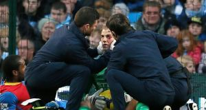 Manchester City goalkeeper Joe Hart is treated for an eye injury after clashing with Crystal Palace's Cameron Jerome. Photograph: Phil Noble/Reuters
