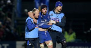Leinster's Sean O'Brien goes off having dislocated his shoulder in the second half. Photograph: Ryan Byrne/Inpho