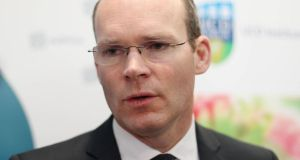 "Minister for Agriculture and Food Simon Coveney: denied the Government was seeking a ""free pass"" on its climate-change obligations. Photograph: Niall Carson/PA Wire"