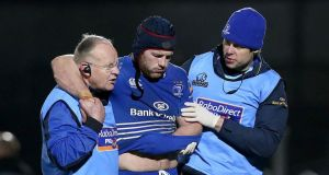 Seán O'Brien is led from the pitch during Saturday's Pro12 game against Ulster. Photograph: Ryan Byrne/Inpho.