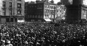 "'At his trial for Alice Brady's murder, Patrick Traynor claimed the gun went off because of ""a belt I got in the arm"".' Above, crowds in Dublin's O'Connell street attending a trades union meeting in September 1913. Photograph: Topical Press Agency/Getty Images"