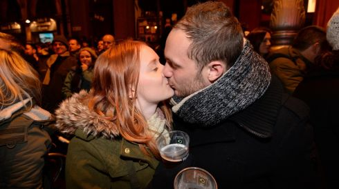 Rhiann Stalker and Jack Tremain  from Aberdeen celebrate the New Year at College Green last night.  Photograph: Dara MacDónaill/The Irish Times