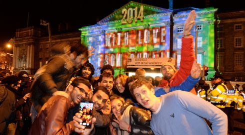 Celebrating New Year's Eve outside Trinity College in Dublin.  Photograph: Dara MacDónaill/The Irish Times