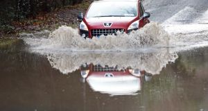 Negotiating a  flooded road near Enniskerry, Co Wicklow, today. Photograph: Eric Luke/The Irish Times