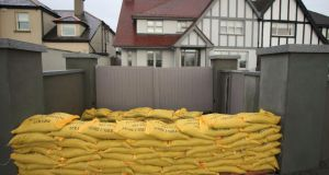 Sandbags outside houses on the Coast Road in Clontarf, Dublin, on Wednesday. Photograph: Gareth Chaney Collins