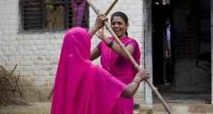 Gulabi Gang members undergoing lathi/stick fighting training. Lathis are the 7 foot bamboo sticks the gang uses for rallies. Photograph: Carol Ryan