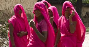 Gulabi Gang members from the village of Rauli Kayanpur dressed in their pink sari uniform. Photograph: Carol Ryan
