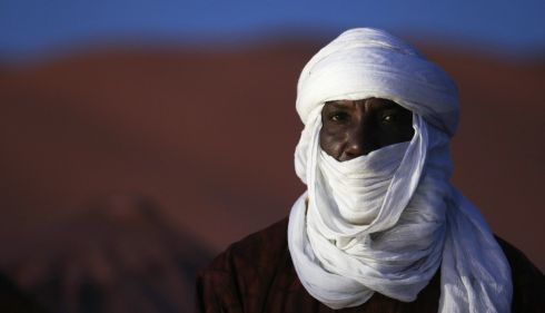 A Tuareg man in the Libyan desert during the 19th Ghat Festival of Culture and Tourism, in Ghat, about 1,360km (845 miles) south of Tripoli December 28, 2013. In the annual event, Tuareg tribes from the region and tourists meet to celebrate Tuareg traditional culture, folklore and heritage. Photograph: Esam Omran Al-Fetori/Reuters