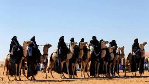 Tuareg men with their camels in the desert during the Ghat Festival. Photograph: Esam Omran Al-Fetori/Reuters