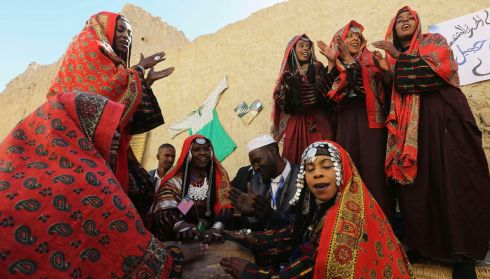 Colourfully dressed Murzuq band members mid-performance. Photograph: Esam Omran Al-Fetori/Reuters