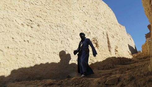 A Tuareg man walks down the stairs in the alleys of the old city of Ghat. Photograph: Esam Omran Al-Fetori/Reuters