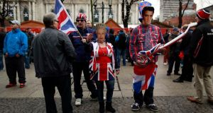 Loyalists in fancy dress march from City Hall in Belfast to mark the first anniversary of the council's decision to restrict the flying of the Union flag. Photograph: Reuters