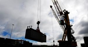 A crane positions a shipping container at Dublin port. An independent study has found that residents in the area are exposed to noise above night-time guidelines set by the World Health Organisation.  Photograph: Aidan Crawley/Bloomberg