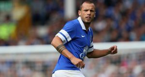 Everton's John Heitinga: has rejected a proposed move to West Ham United