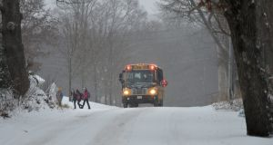 Children dropped off by a school bus as snow falls in Norfolk, Massachusetts. Photograph: Matt Campbell/EPA