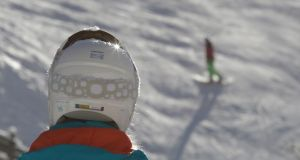 Ski safe: a  skier wearing a helmet  in the Tyrolean ski resort of Ochsengarten. Photograph:  Leonhard Foeger/Reuters