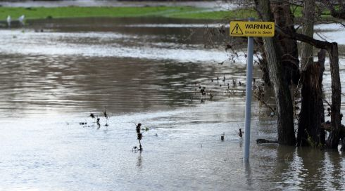 The swollen river Mole spills its banks in Leatherhead, Surrey, southwest of London. Photograph: Andy Rain/EPA