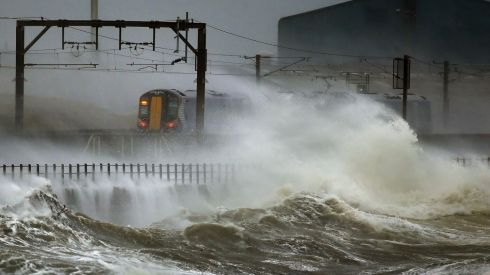 A train passes through the coast at Saltcoats in Scotland. Photograph: Danny Lawson/PA Wire
