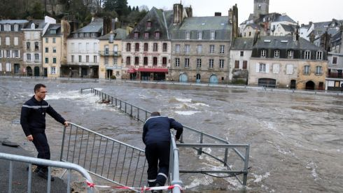 Police officer checks fences as the centre of Quimperle, western France, which  is flooded by the Laita river. Floods are washing over northwestern France, as heavy rains coupled with unusually high tides leave the streets of some coastal towns underwater.