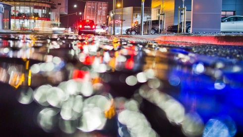 Wet cobblestones reflect the lights of cars on a street in Frankfurt Main, Germany. Photograph:  Frank Rumpenhorst/EPA