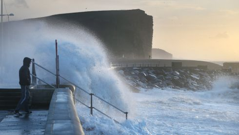 A man looks out from the seafront West Bay during stormy weather on January 3, 2014 in Dorset, England. Storm and flood warnings have been issued for the south west of England. Photograph: Peter Macdiarmid/Getty Images